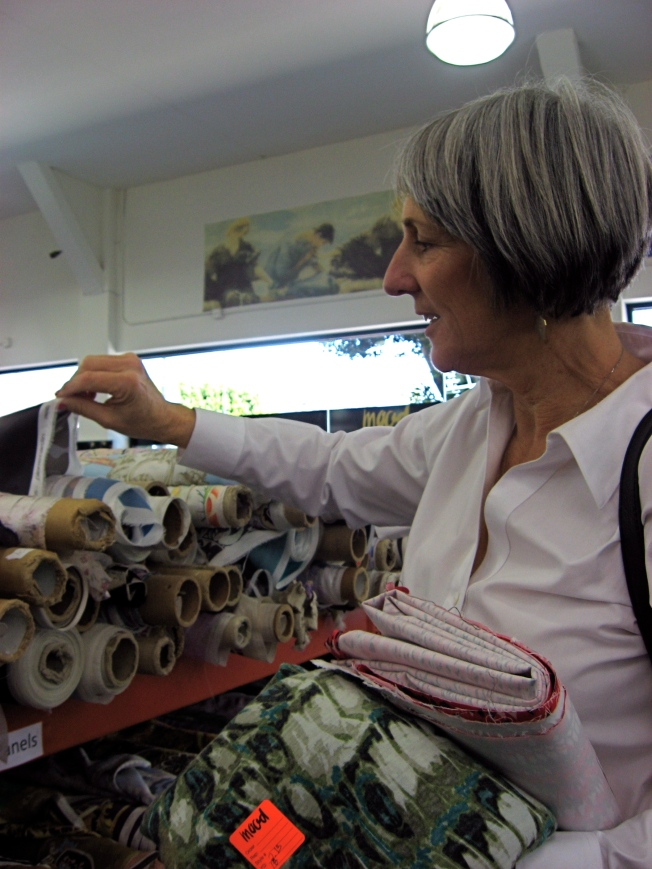 Sandra is captivated by all the luscious fabrics.