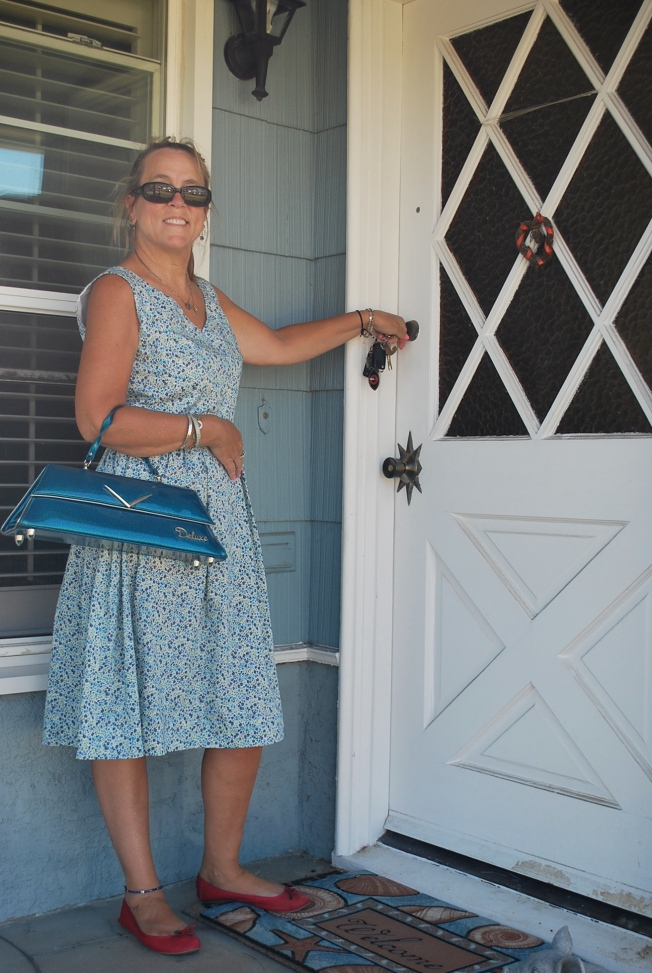 Jennifer is on the front porch of her newly purchased home!
